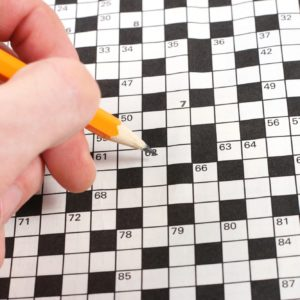 English language student completing a crossword puzzle