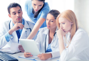 Doctors and nurses reading OET questions